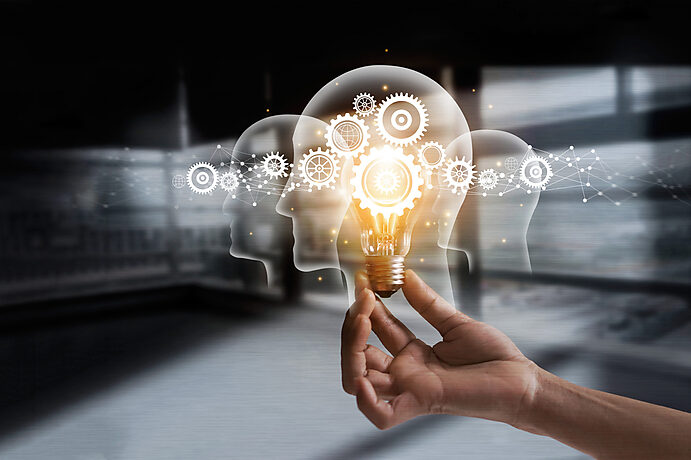 Lightbulb Being Held to Symbolize Ideas and Innovation