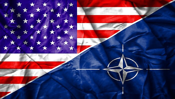 Rectangle cut down the diagonal between the US flag on the left and the NATO flat on the right