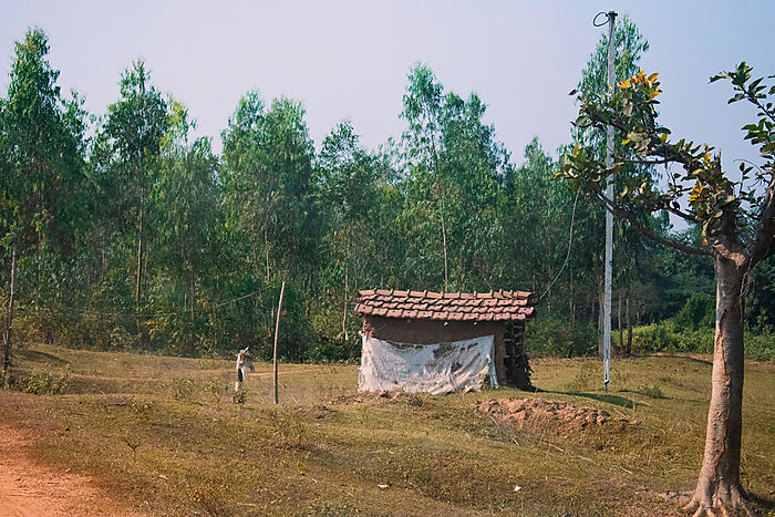 Mud hut near forest in India