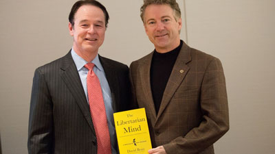 Rand Paul and David Boaz with book Libertarian Mind